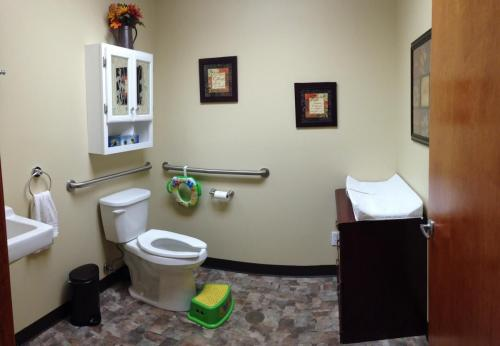 Our bathroom.  Complete with a step stool, potty seat & a baby changing station for the little ones!
